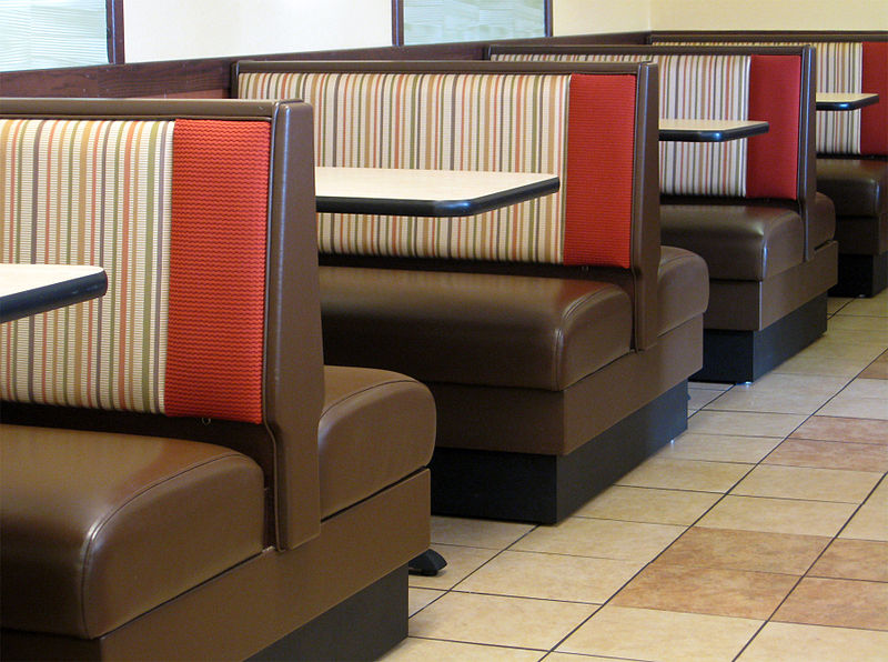 brown restaurant booths with tables